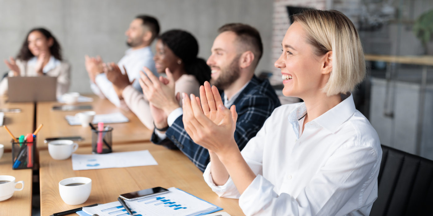 Coworkers Applauding Celebrating Business Success During Corporate Meeting In Office
