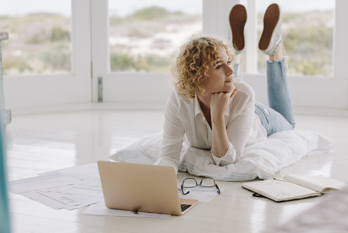 Woman Working from Home Lying on Floor